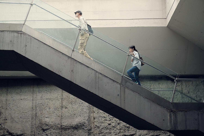 Westfriedhof U-Bahn station access stairway with passengers moving upstairs