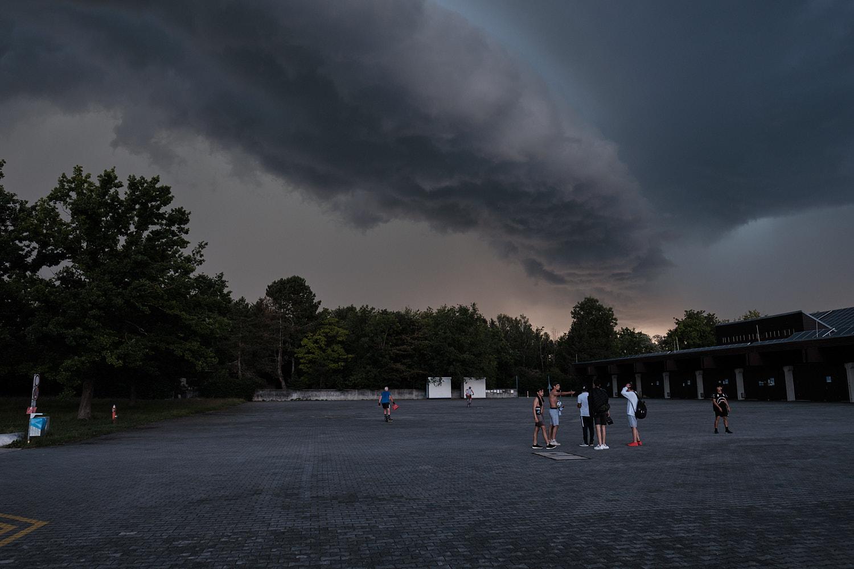 1972 Olympic Games Regatta course Oberschleißheim near Munich. Start side and canoe storages under a menacing sky just before the storm.