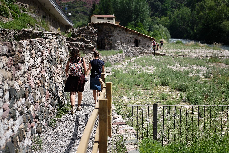 Tourists visiting the old but still in use salt prospection installations in Gerri de la Sal, Lleida, Spain