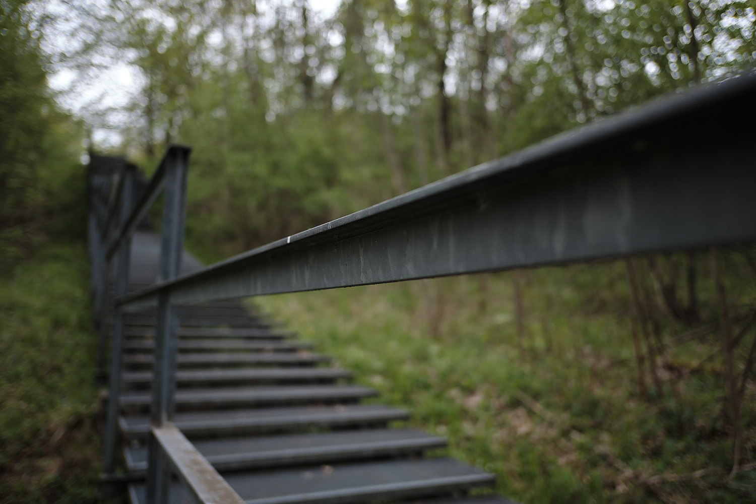 Modern metal stairway from the forest into the Memorial Site of the KZ-Buchenwald, Weimar, Germany