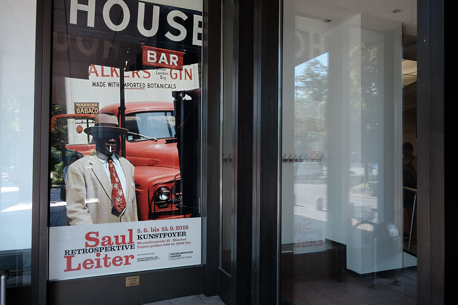 Exposition's poster with photograph of Saul Leiter outside the building