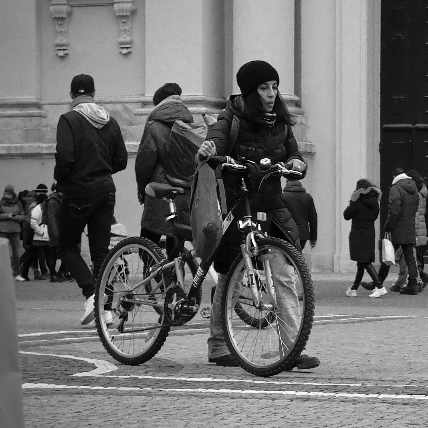 Bypassers going about their business in the Odeonsplatz, Munich, Germany