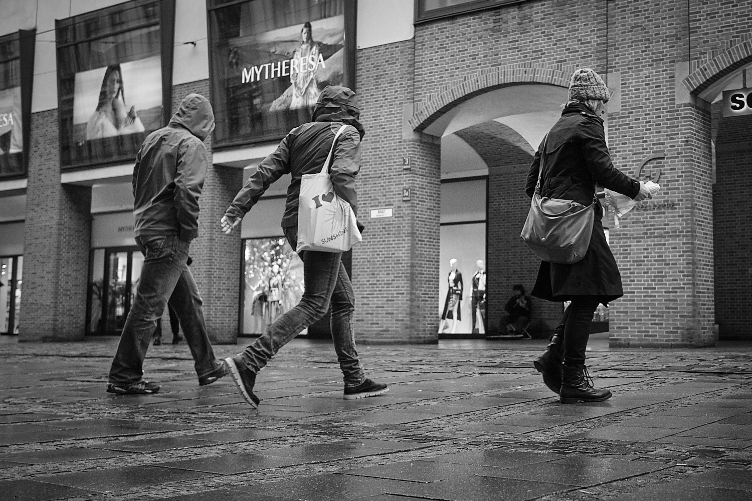 Bypassers going about their business in the Maffeistrasse, Munich, Germany
