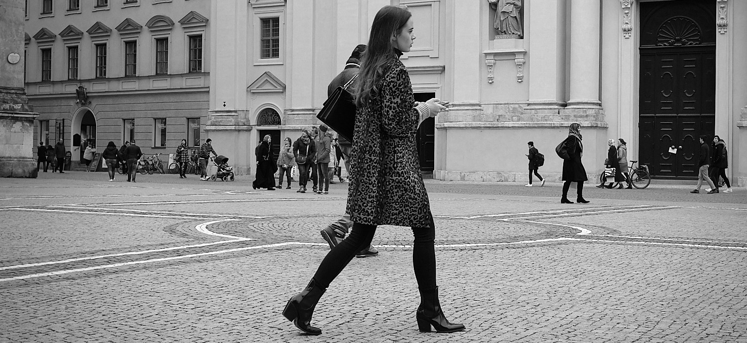 Fashionable lady going about her business in the Odeonsplatz, Munich, Germany