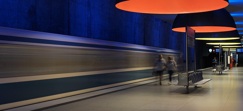 Westfriedhof long exposition U-Bahn departing station, platform is emptying. Orange and yellow ceiling hanging lamps from Ingo Maurer