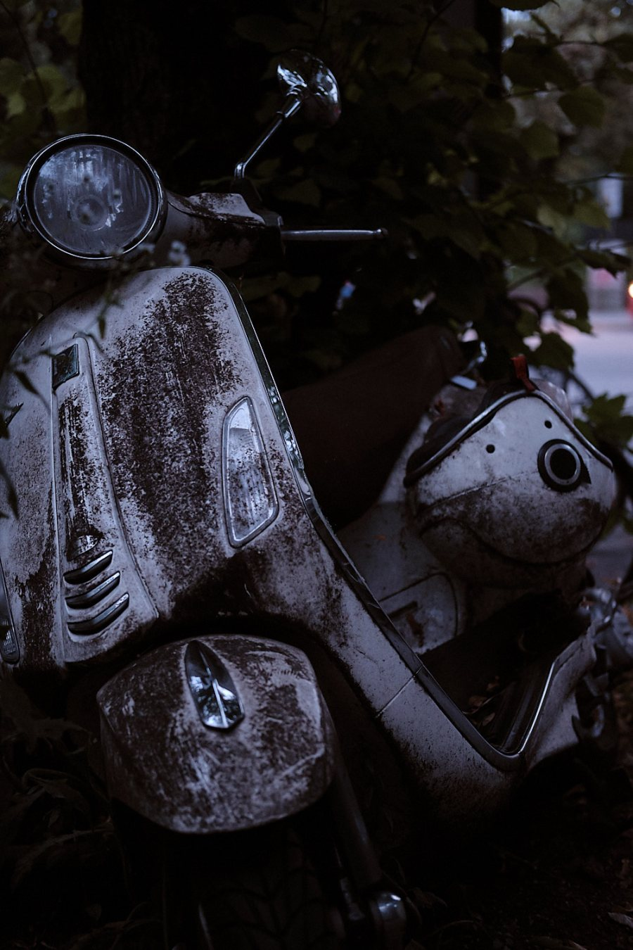 Disregarded and abandoned Piaggio Vespa in the streets of Munich, Germany. The legacy of the outstanding ingenuity of the Italian engineers of the 20th century.