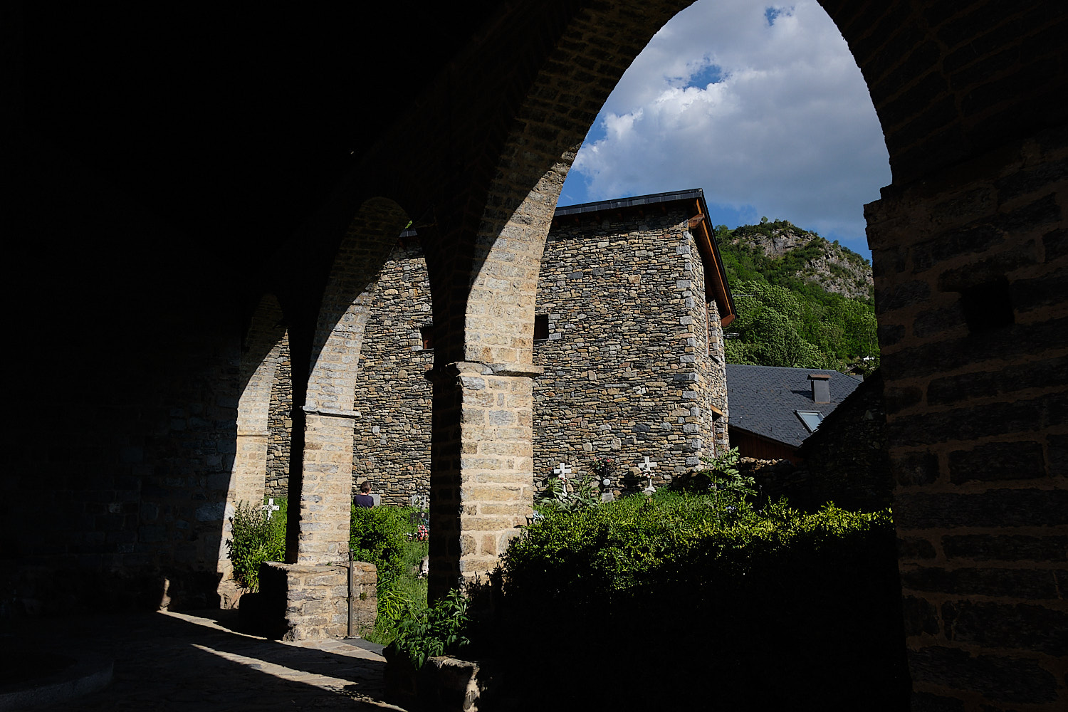 Romanesque church entrance archs and shade in the sunset in Barruera and Durro, Vall de Boí, Pyrenees, Spain