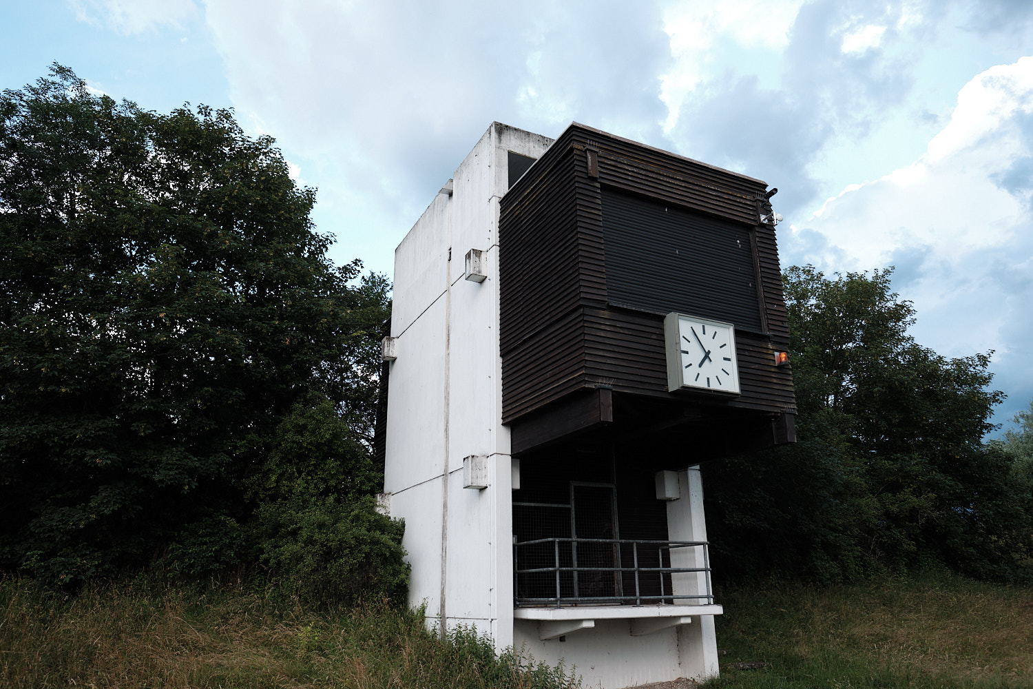 1972 Olympic Games Regatta course Oberschleißheim near Munich. Observation tower at the end side of the Regatta course with watch. Concrete building
