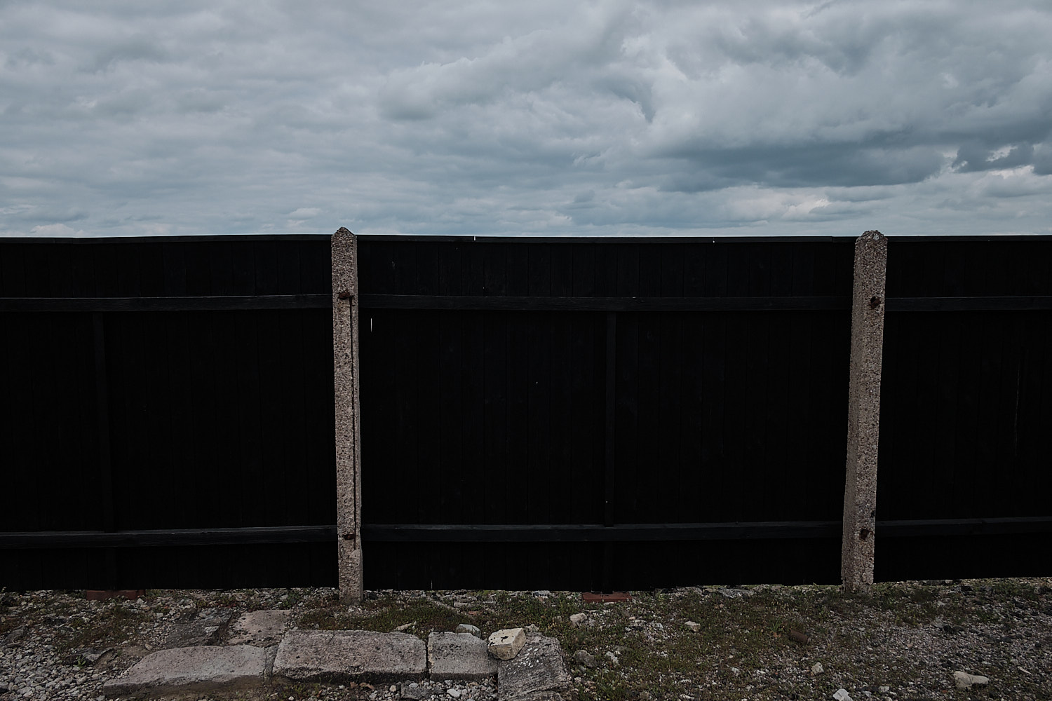 Black omnious fence around the torture and Crematorium buliding in the Memorial Site of the KZ-Buchenwald, Weimar, Germany