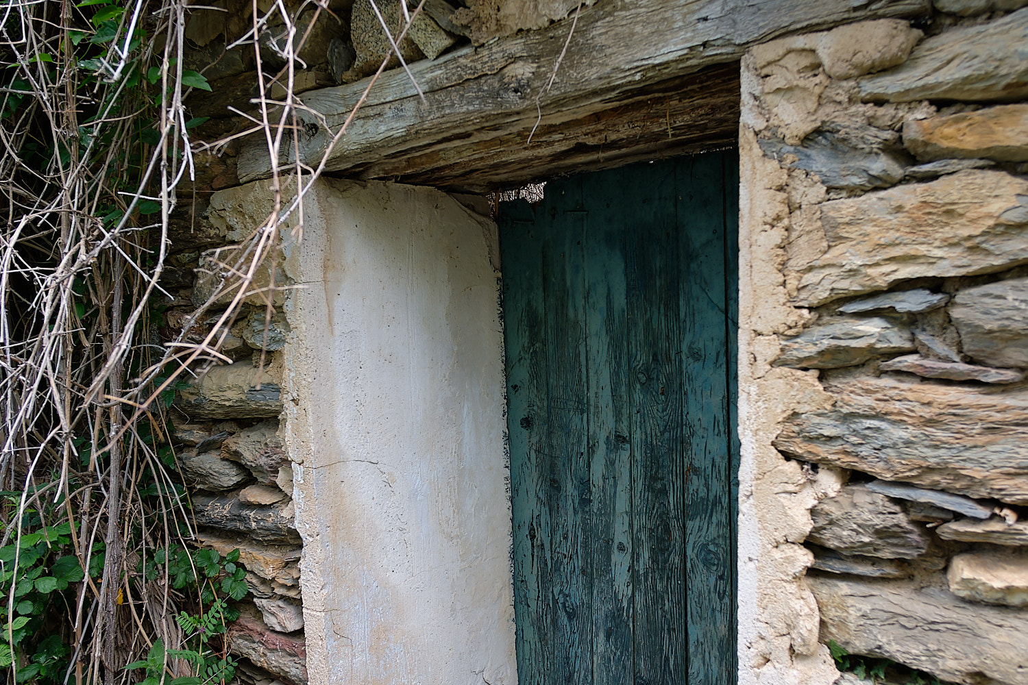 Abandoned house entrance at Saraís (ghost town), Vall de Boí, Pyrenees, Spain