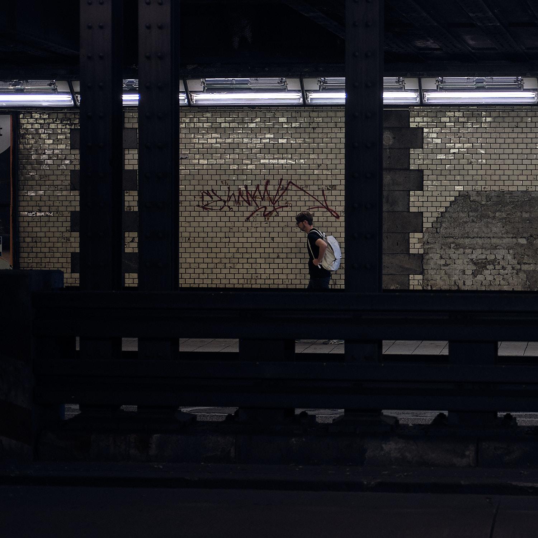 male pedestrian walking under the tunnel of Paul-Heyse in Munich