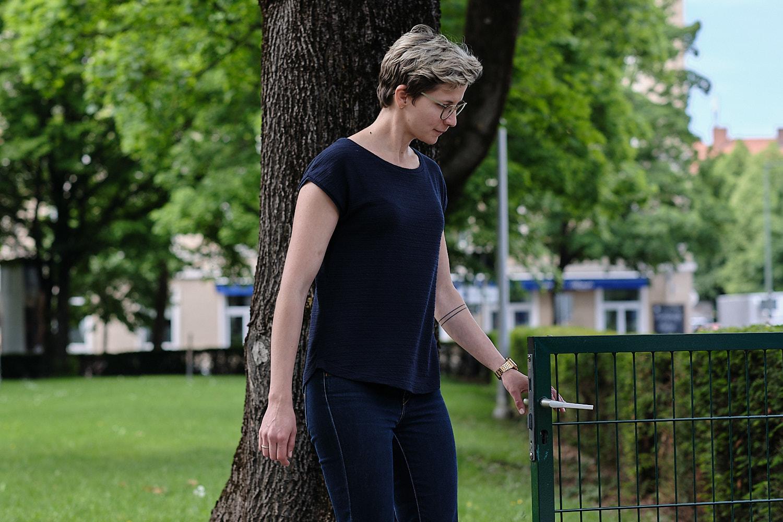 Model opening a garden gate, Munich, Germany
