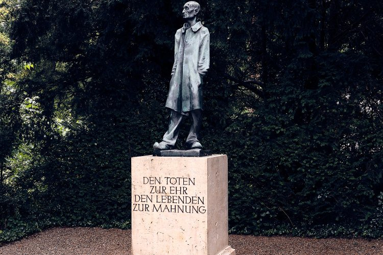 """Historical site of the concentration camp of Dachau. Sculpture """"The unknown prisoner"""" by Fritz Koelle."""