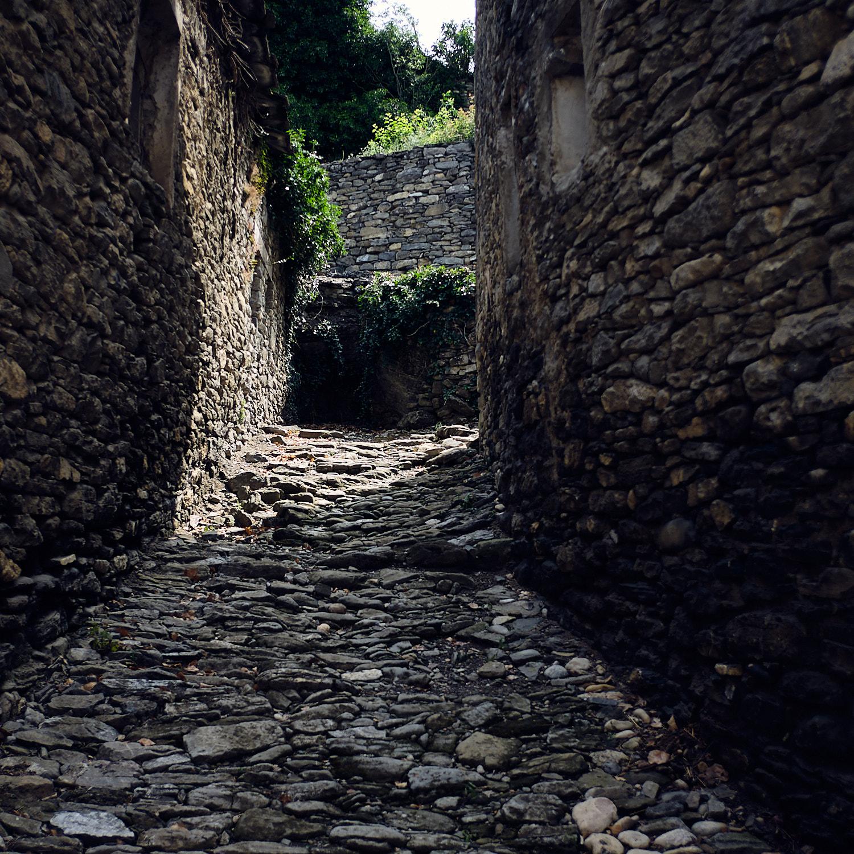 Street on the climb to the higher town side of Montañana, Aragón, Spain