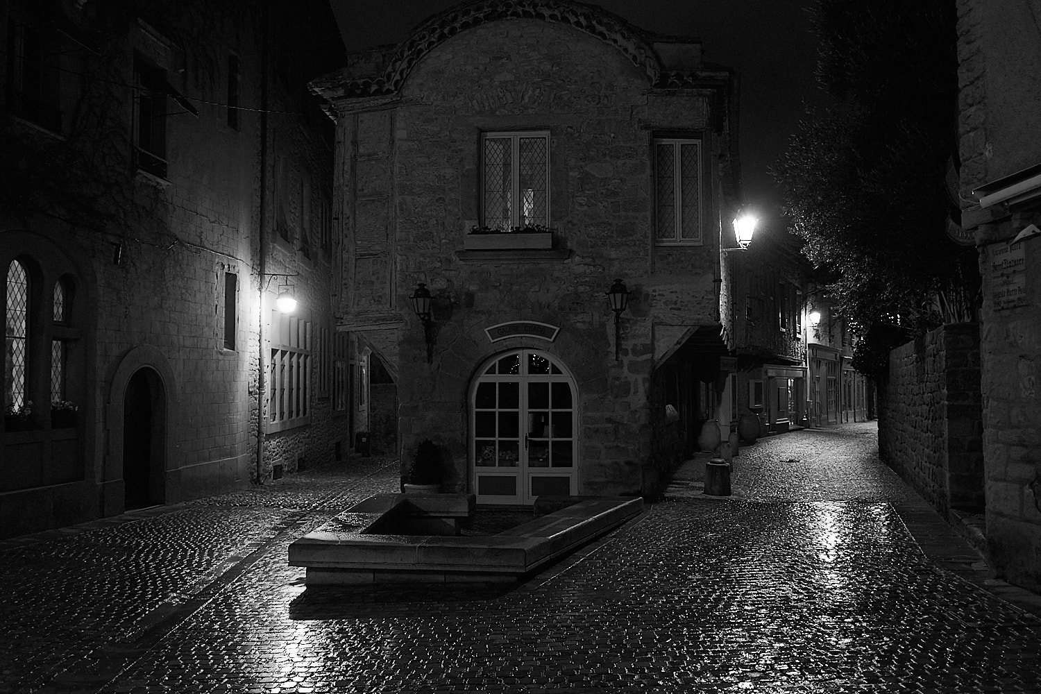 Night street view with wet coblestones after the rain in the fortress city of Carcassone in south France