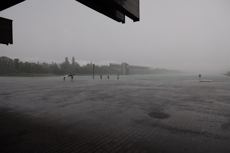 1972 Olympic Games Regatta course Oberschleißheim near Munich. Start side and canoe storages under strong stormy rain.
