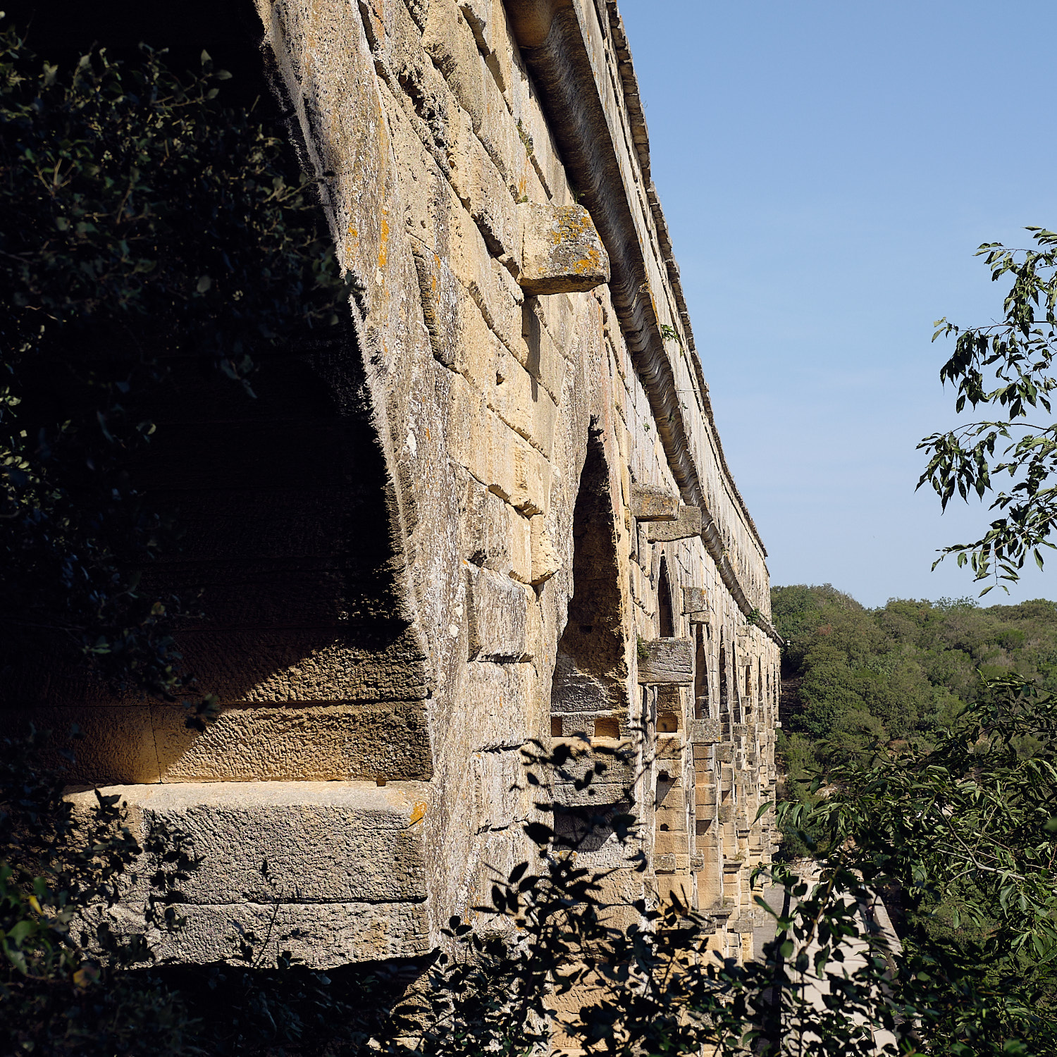 Pont du Gard the best preserved bridge of a 50 Km aqueduct with 35Km of tunnels ground in rock and several bridges made of limestone with rudimentary tools and cranes. It stands proud under the heat of the sun of June in the Provence.