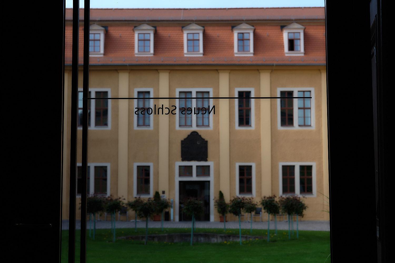 View of the new building at Ettersburg through the glass door of the Ettersburg Schloss, Weimar, Germany