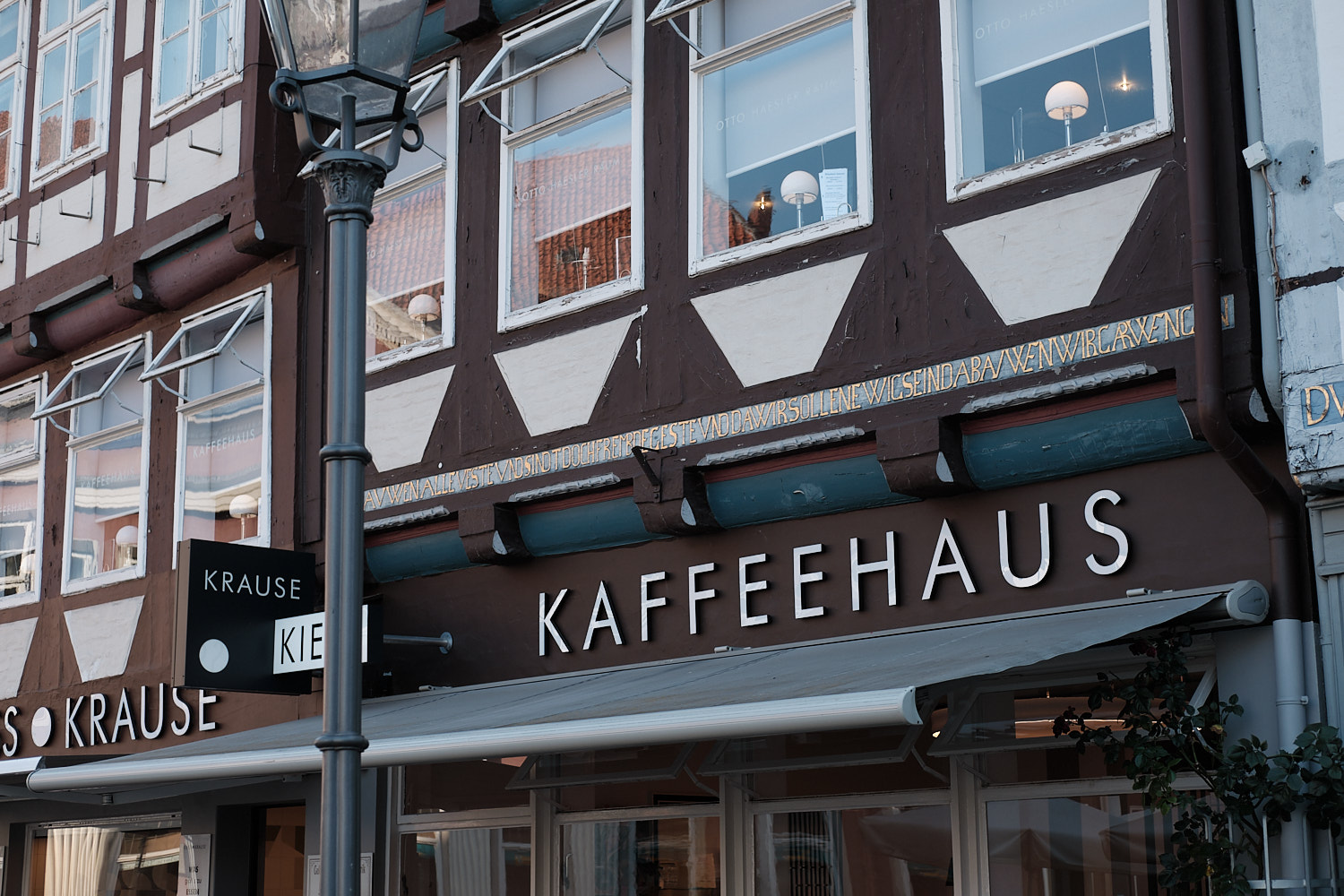 A late afternoon closure to the day in the streets of the old town in Celle and yet a Bauhaus styled Cafe.